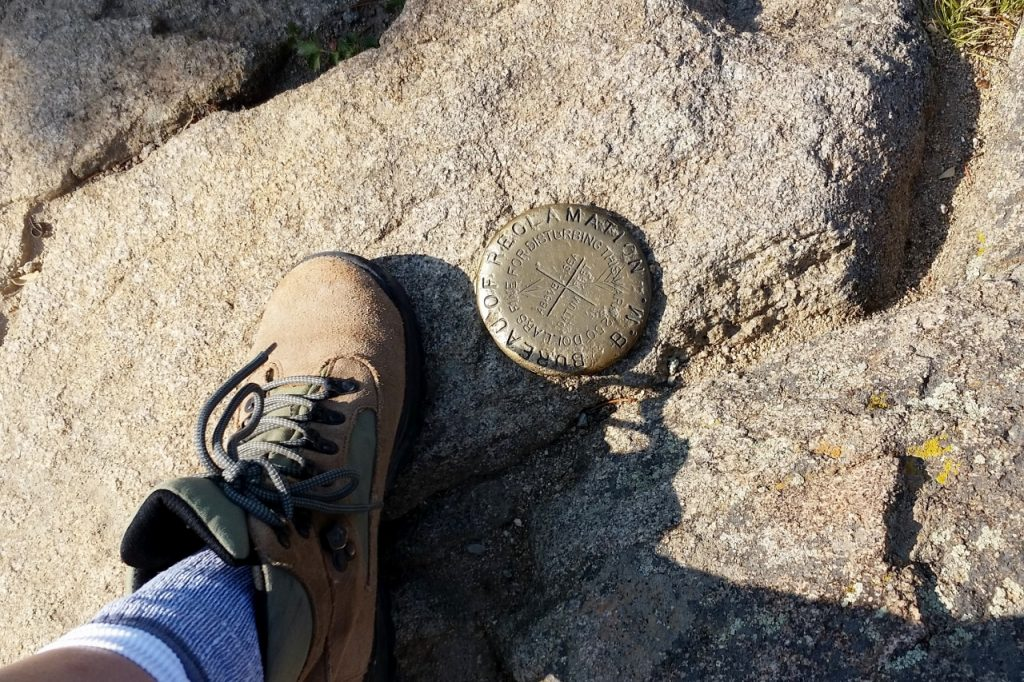 The survey marker at the top of Deer Mountain